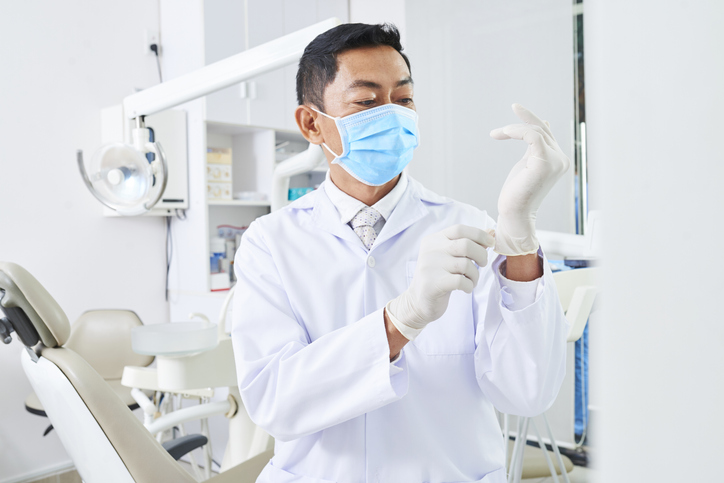 Professional dentist preparing for work