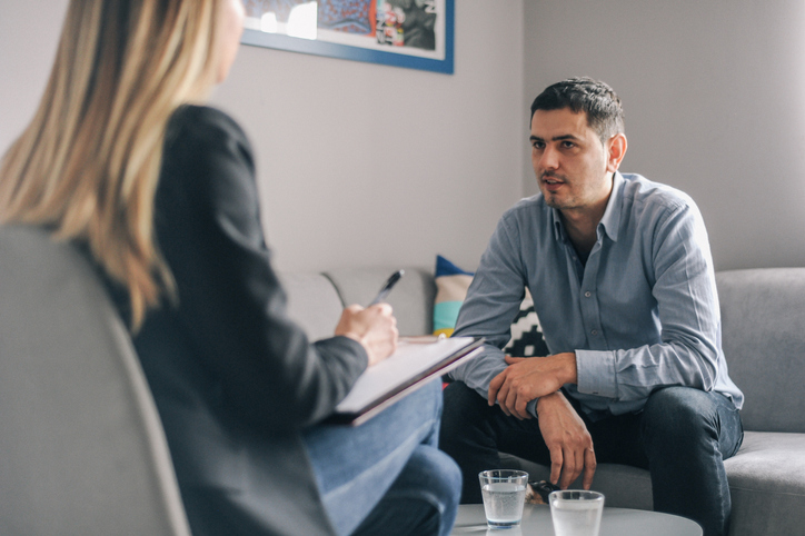 Mid age man having on on one counselling meeting