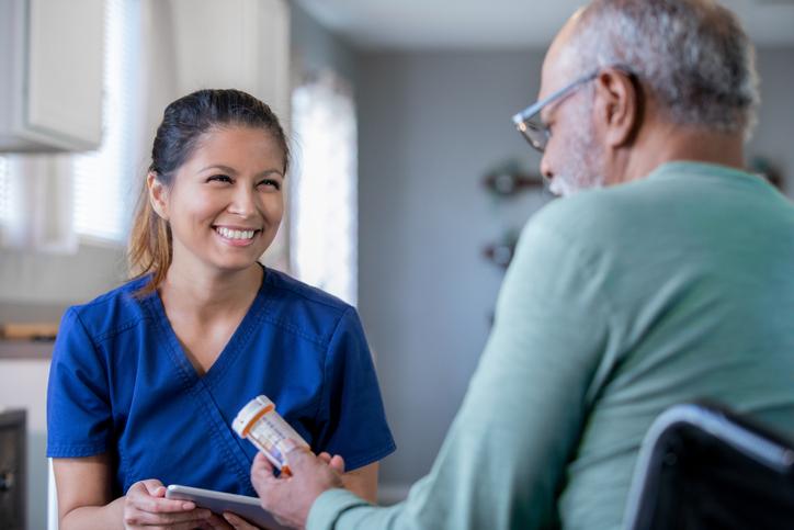 Home healthcare nurse brings new prescriptions for senior man